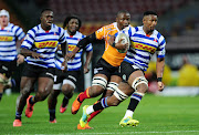 Sikhumbuzo Notshe of Western Province goes past Free State Cheetahs captain Oupa Mohoje during the Currie Cup game at the Newlands Rugby Stadium, Cape Town on August 25 2018.