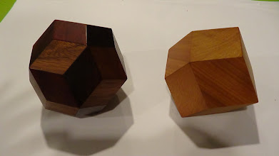 Photo: Rhombic triacontahedron and rhombic dodecahedron, by Bob Rollings.