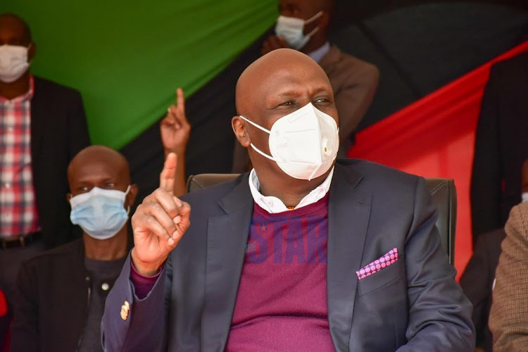 Kanu party leader Gideon Moi showS the party's one finger sign during a BBI meeting held by the party at City Park, Nairobi. on December 10, 2020.