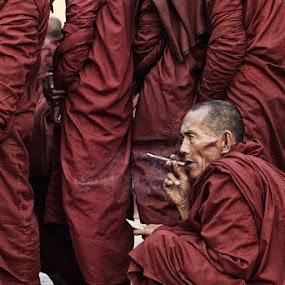Harvest Festival line up by Felix Hug - People Street & Candids ( myanmar, monk, smoking, wait )