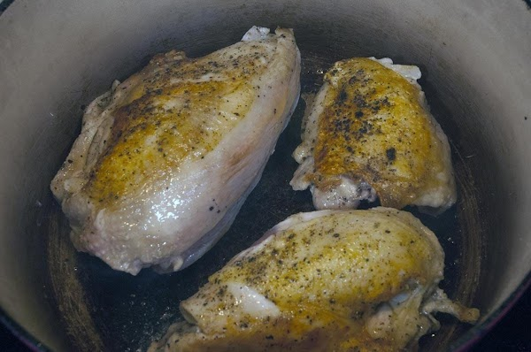 Turn the chicken over and sauté for an additional 5 minutes.