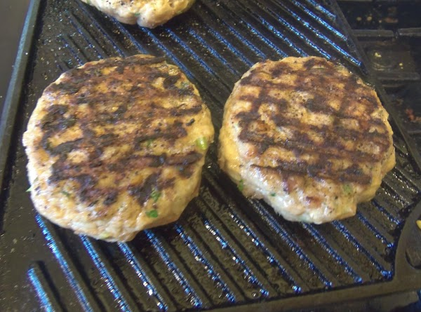 Sprinkle the burgers with salt and pepper and add them to the hot grill...