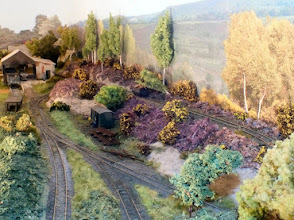 Photo: 002 Overview of the layout in the opposite direction looking across the standard gauge transfer shed and the high level track that serves a jetty .
