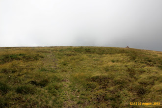Photo: As you clear the gully cairn appears ahead and to the right