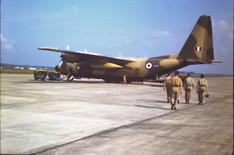 Photo: 74 Sqn personnel board the Herc bound for Butterworth.