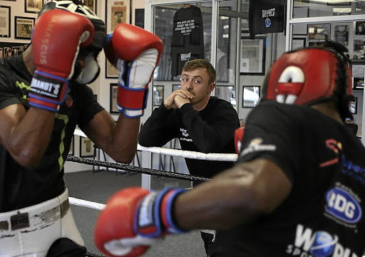 Trainer Damien Durandt watches two boxers in a sparring session. He is excited to be returning to training with the necessary precautions in place. / Alon Skuy