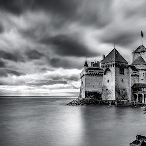Chateau de Chillon by Nikolas Ananggadipa - Black & White Buildings & Architecture ( contrast, canon, clouds, building, europe, black & white, dramatic, switzerland, castle, long exposure, lake, historical, travel, public,  )