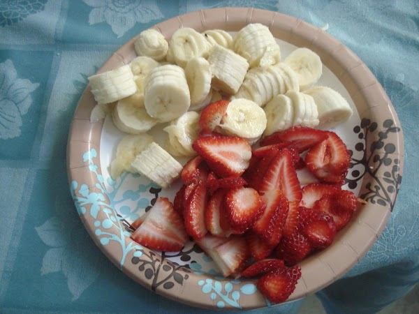 Slice bananas and strawberries.