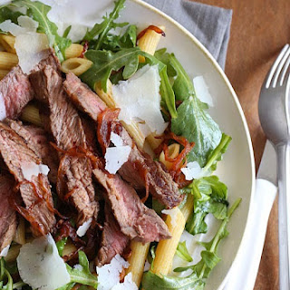 Steak & Caramelized Onions with Arugula and Quinoa Penne