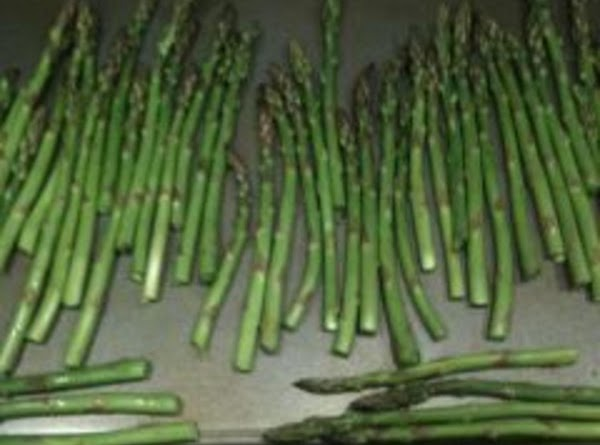 Line the asparagus in a single layer on a baking sheet.  Drizzle with...