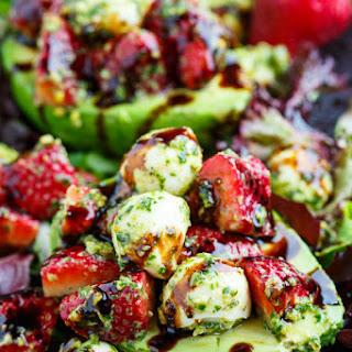 Strawberry Caprese Stuffed Avocados with Pistachio Pesto