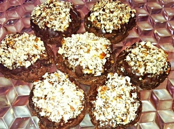 Dip the tops of cookies in the chocolate and dip in to finely chopped...