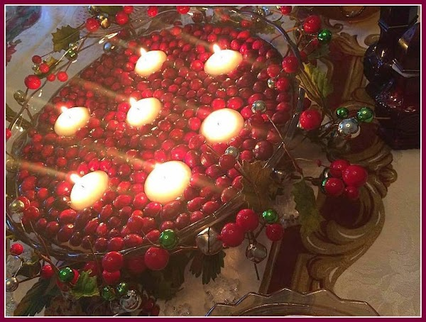 Fill with water, add your cranberries and then lastly gently place your floating candles...