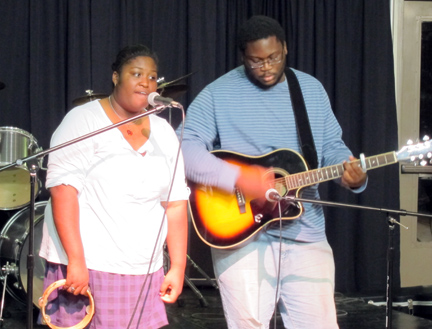 """Photo: Charles Rouse played guitar while Courtney Young sang """"The Only Exception."""""""