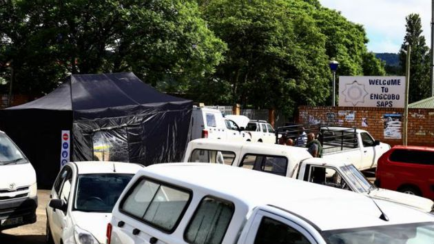 A police van that was driven by some police members who were gunned down at Engcobo Police station is seen covered in a forensic tent. File photo