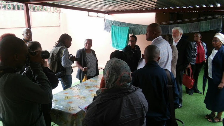 Journalists take pictures inside the Masego Home for the Elderly in Krugersdorp. Picture: PENWELL DLAMINI