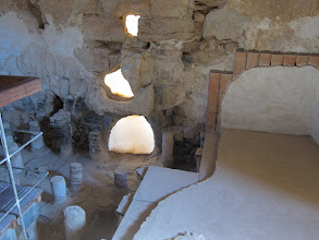 Photo: Partially-reconstructed bath showing raised floor and hollow walls for circulating steam