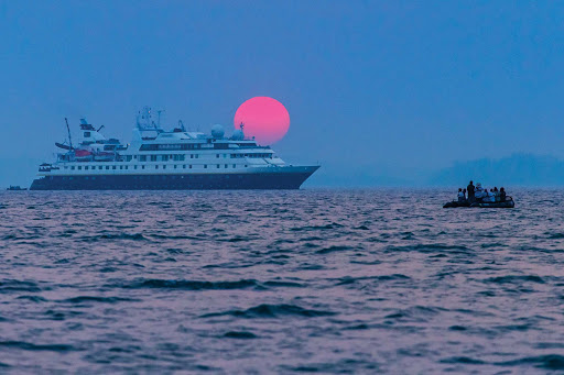 lindblad-ship-pink-sunset.jpg - Enjoy a perfect sunset on a Lindblad Expeditions voyage.