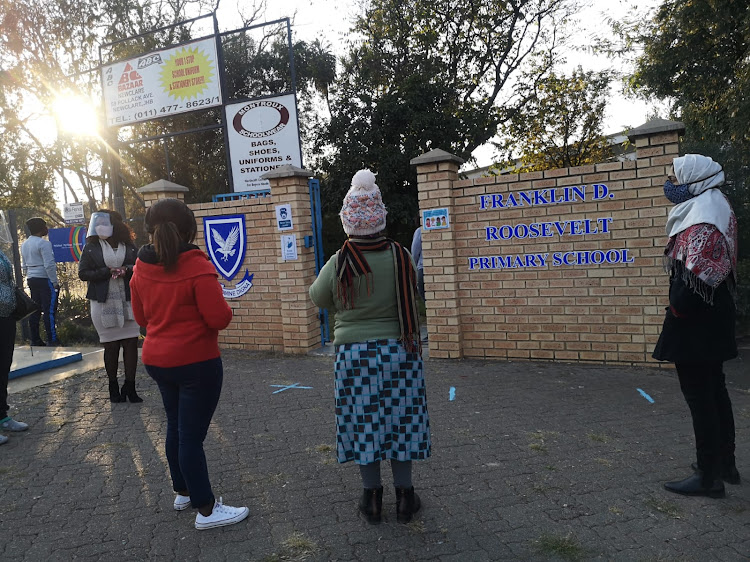 Parents at the gate after dropping their children at this primary school in Johannesburg.