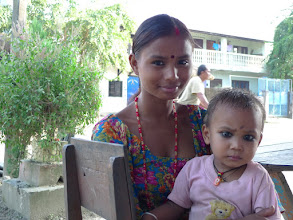 Photo: Tharu girl, sixteen with a two year old daughter ...