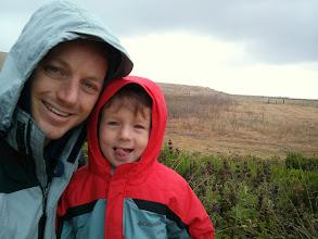 Photo: Daddy and Finn Hike in The Rain