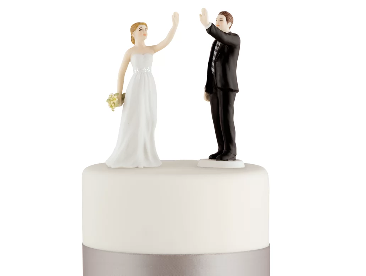 high-five bride and groom topper