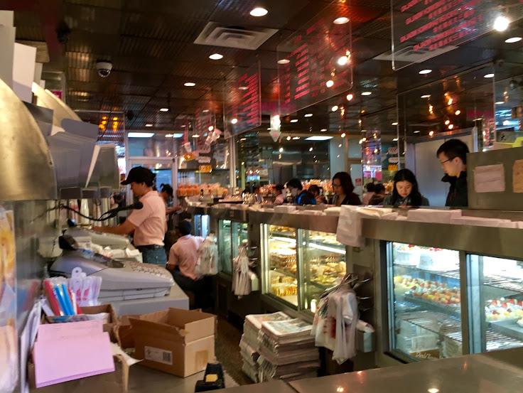 Behind the counter at Tai Pan Bakery.