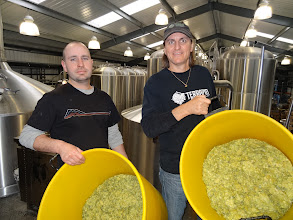 Photo: Spike Buckowski from Terrapin (right) and Rob Lovatt from Thornbridge (left) add a dose of whole leaf hops to their collaborative Imperial Rye ESB.