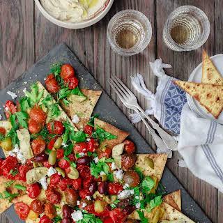 """Mediterranean Roasted Tomato """"Nachos""""."""
