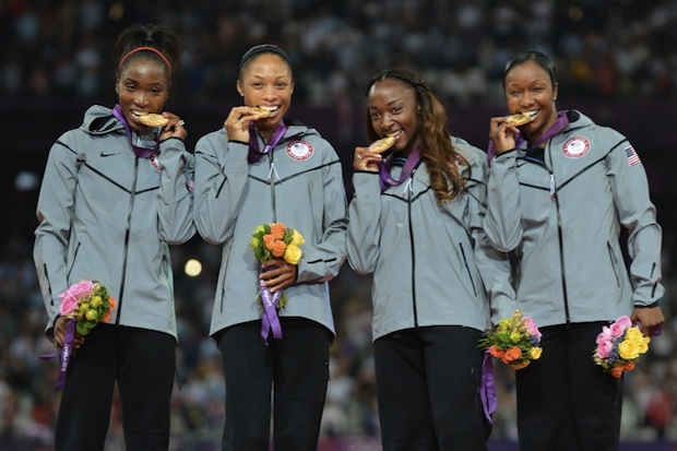 Photo: US' gold medalists Carmelita Jeter, Tianna Madison, Allyson Felix and Bianca Knight pose on the podium of the women's 4 x 100m relay final at the athletics event of the London 2012 Olympic Games on August 10, 2012 in London. AFP PHOTO / JEWEL SAMAD