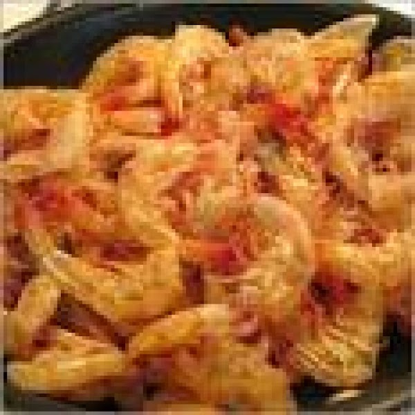 Return insert and add shrimp shells to water in which crab was cooked; bring...