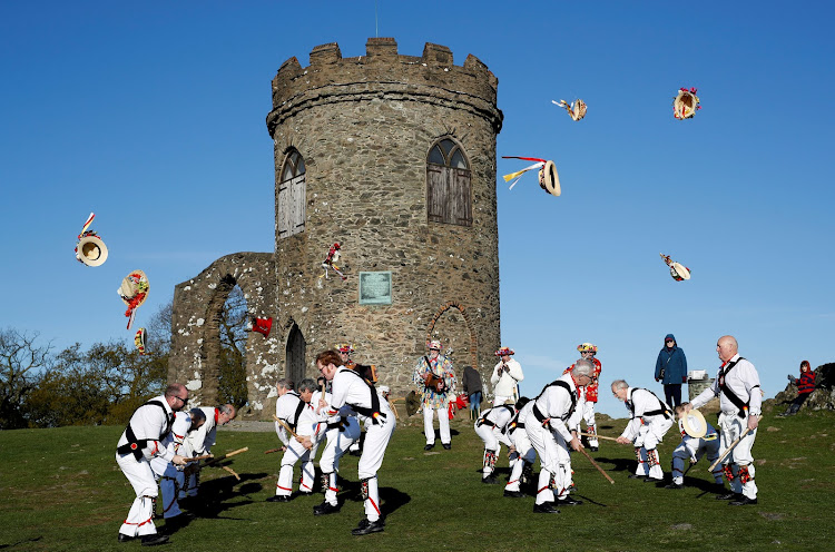 Leicester Morrismen throw their hats during May Day celebrations at Bradgate Park in Newtown Linford, Britain.