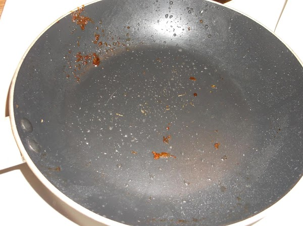Drain all grease from skillet, but do not wipe skillet clean.