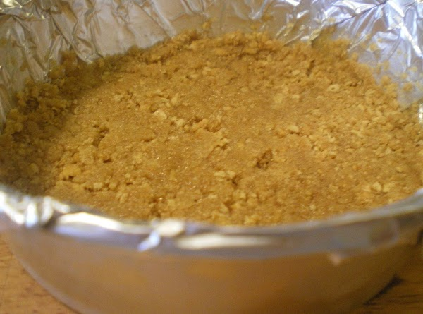 Preheat oven to 350 degrees.  Combine graham crackers and sugar in a bowl....