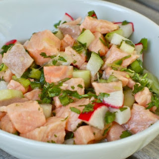Fresh Salmon Ceviche with Cucumbers and Radishes.