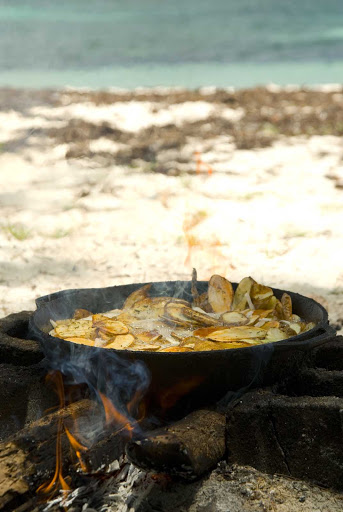 Have a tropical-style lunch on the beach while visiting the Abaco Islands in the Bahamas.