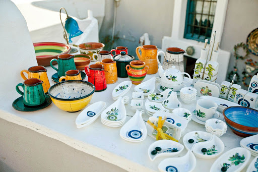 Dinnerware-shop-in-Oia.jpg - Pottery and earthenware at a shop along the main walkway in Oia on the Greek island of Santorini.