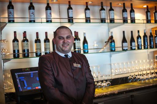 Celebrity-Infinity-bartender - Bartender Tomislav Tomas, in Cellar Masters aboard Celebrity Infinity.