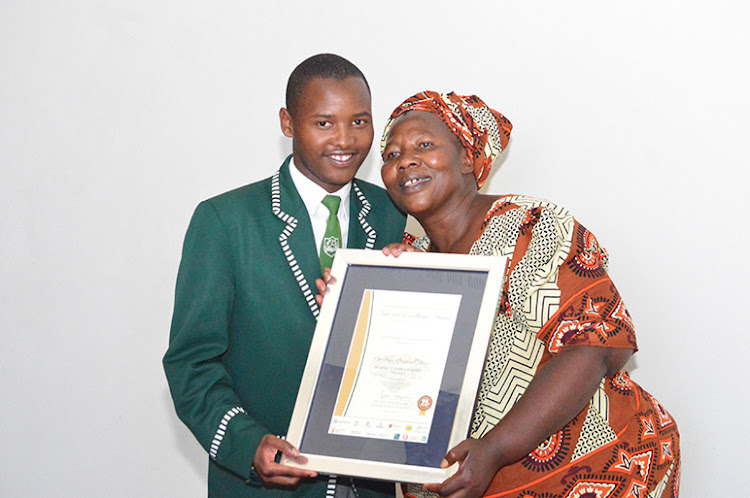 Avukile Austin Nkayi from Ngcobo's Nyanga Senior Secondary School, who obtained seven distinctions, with his mother Thembeka.