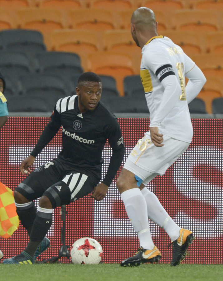 Thabiso Kutumela of Orlando Pirates and Robyn Johannes of Cape Town City during the Absa Premiership match at FNB Stadium on September 19, 2017 in Johannesburg, South Africa.