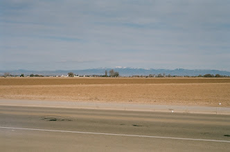 Photo: Farm across from the subdivision, mountains in the back.
