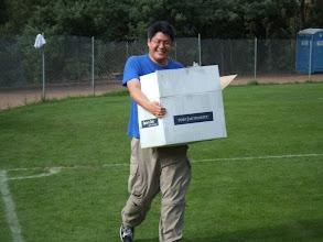 Photo: Richard Liang and his box of T-shirts