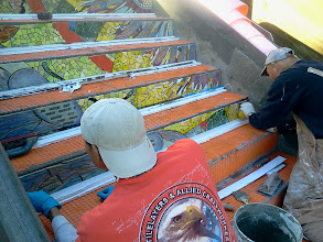 Photo: Fifth full day of work (October 31, 2013): KZ Tile workers (left to right: Sing and Henry) on fourth flight of steps from bottom of the Hidden Garden Steps (16th Avenue, between Kirkham and Lawton streets in San Francisco's Inner Sunset District), continuing to install the 148-step ceramic-tile mosaic designed and created by project artists Aileen Barr and Colette Crutcher. More than 80 pieces were in place by the end of the day. For more information about this volunteer-driven community-based project supported by the San Francisco Parks Alliance, the San Francisco Department of Public Works Street Parks Program, and hundreds of individual donors, please visit our website at http://hiddengardensteps.org.