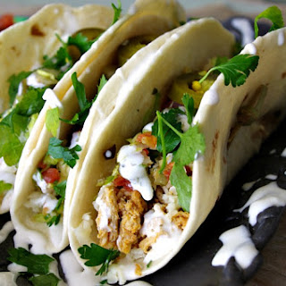 Pork Tacos with White Cheddar, Poblano Pico and Lime Crema