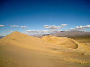 Photo: Sand dunes, the postcards of the desert. We climb the Kelso Dunes slowly and enjoy the walk up. V is somewhere on the easternmost dune (ahead.)