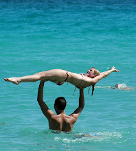 Photo: guy holding woman in air at beach. cuba. Tracey Eaton photo