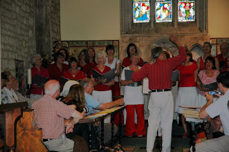 Photo: Vince Ash leading Key Voices in their performance in Priston Church.© Owain Jones 2008