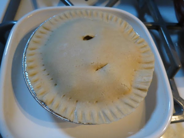 Add top crust and crimp around the edges with fork.  Make two slits...