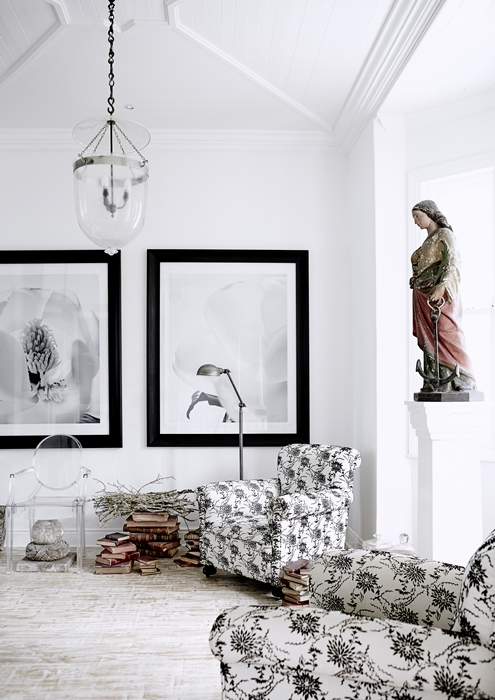 The black and white oversized photographs in this seating area are by Johannesburg husband and wife team Dook and Leanna.