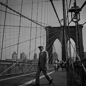 Suited Up for Walking by Marc Brian Queyquep - People Street & Candids ( brooklyn bridge, tourist, walking, bridge, new york )